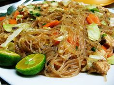 Pancit, or pansit, is a quick-cooked noodle dish that is one of the quintessential meals of Filipino cuisine. All kinds are available, and pancit is as popular at street stands as it is at family gatherings. The most common variety is pancit bihon, with r Filipino Noodles, Filipino Pancit, Lumpia Recipe Filipino, Pancit Bihon Recipe Panlasang Pinoy, Mie Noodles, Pancit Noodles, Asian Noodles, Comida Filipina, Philippine Cuisine
