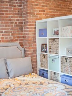 For an apartment studio, use an open shelf (like this one!) plus a curtain to make a totally separate bedroom!