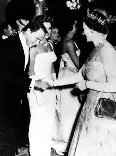 """Frank Sinatra is presented to Queen Elizabeth II at the Odeon Theatre in London at the premiere of """"Me and the Colonel,"""" 1958."""