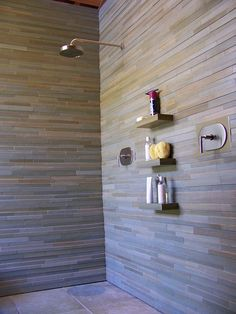 stacked stone wall shower with shelves (by samuel brown tile, via Flickr)