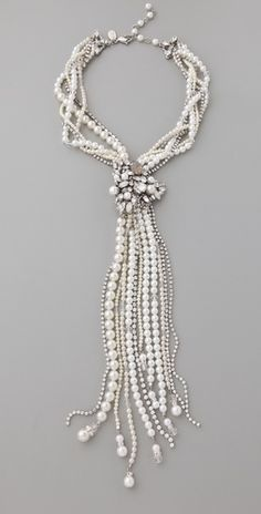 Use old necklaces and pin together with broach... AMAZING!