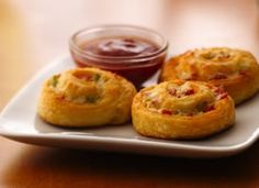 Pizza Pinwheel appetizers. Serve pizza toppings swirled in a tender crescent pastry with a dipping sauce at your next tailgate get-together. #appetizers  GO NOLES!
