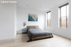 Williamsburg bedroom with monochromatic tones and matte-finish wide-plank hardwood floor.