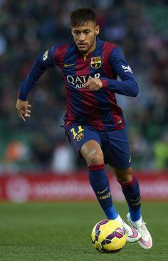 Neymar JR of Barcelona runs with the ball during the La Liga match between Elche FC and FC Barcelona at Estadio Manuel Martinez Valero on January 24, 2015 in Elche, Spain.