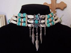 Totally awesome piece - flower, feathers and Native American style - I love it.