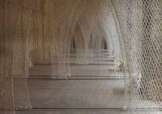 """Fibre Columns / Romanesque Church"". Materials: Nylon. Techniques: Toshiko Horiucchi, ""Romanesque church"", Musee Jean Lurcat de la tapisserie contemporaine, Angers, France."