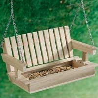 I found the instructions to make this cute porch swing bird feeder at the Birds and Blooms website. Porch Swing Bird Feeder This porch swing bird feeder will delight people and birds alike! Unique Bird Feeders, Best Bird Feeders, Bird House Feeder, Diy Bird Feeder, Small Bird Feeder, Popsicle Stick Crafts, Popsicle Sticks, Craft Stick Crafts, Wood Crafts