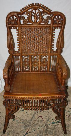 Heywood Wakefield wicker arm chair with elaborate