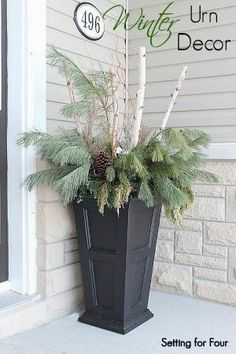 Beautiful Urn decor with birch branches,curly willow, fresh pine and large pinecones by annmarie