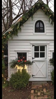 Christmas garden shed.as if the shed wasn't cute enough with that adorable dutch door and that little window tucked up under the eaves.they had to christmas it up. afraid i'd spend waaaaay too much time just hanging out in the garden shed. Christmas Garden, Noel Christmas, Outdoor Christmas Decorations, Country Christmas, Winter Christmas, Christmas Lights, Cottage Christmas, Christmas Window Boxes, Simple Christmas