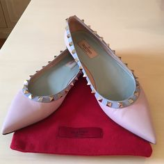 HP Valentino Watercolor Rockstud  Ballerina Flat Pyramid studs follow the trim on a pastel pink and blue leather flat with a pointed toe. Mint green inner sole. Leather upper, lining and sole. Worn a couple of times and in excellent condition with minor, barely noticeable scuff to toe as can be seen in photos. Comes with red felt Valentino dust bag. Valentino Shoes Flats & Loafers