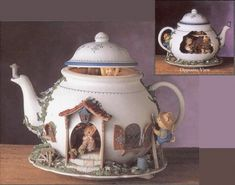 Teapot Bungalow: Plays music while the Whiskerflisk family moves about doing chores, baby peeks out from the lid that moves up & down. Mama's spinning wheel turns, while Missy sweeps at the doorway & Grandma stirs the batter. Lighted musical teapot can turn on its lazy susan base for case to display either side.