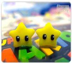 1 Pair Of Cute Unique super Mario star Earrings Studs. $13.99, via Etsy.