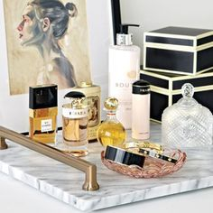 Set your perfume on a marble board with fashion-forward water color paintings in the backdrop for an elevated beauty space.