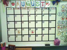 White board calendar with moveable magnetic pieces and a banner for the months!