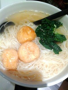 Chinese rice vermicelli soup with mustard greens and fish puffs.