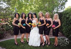 Black dress, colored bouquets with Maid of Honor's and Bride's in multicolors @Julie Sheppard