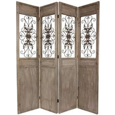 This large four panel floor screen was hand-crafted from beautiful reclaimed wood planks and fine scrollworked metal. At seven feet tall, it is an impressive decorative screen, ideal for dividing a large living space, creating a private nook, or redirecting foot traffic in a professional office or small business.