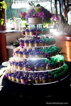Peacock-themed cupcake tower - so colorful #cupcaketower #peacock #cupcakedisplay