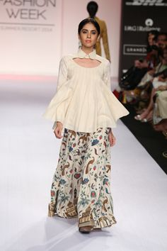 Summer/Resort 2014. Purvi Doshi- cotton flowy wear with a western peplum kinda top. I liked the twist and play of colours against cream colour. Description of Pinner Mahua Roy Chowdhury