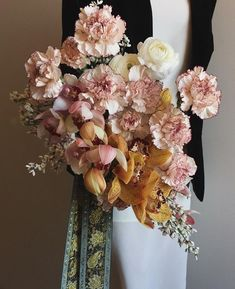 Bridal bouquet of white carnations with pink edges mustard colored cymbidium orchids from Running Wild Florals Carnation Bouquet, Orchid Bouquet, Dried Flower Bouquet, Carnations, Floral Bouquets, Classic Wedding Flowers, Rose Wedding Bouquet, Rose Bouquet, Floral Wedding