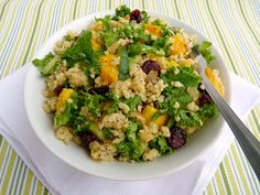 Mango, Millet & Kale Salad with cranberries and cilantro.