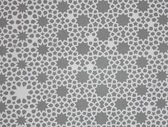 Alhambra Stars Fabric An off white cotton twill fabric with a printed grey star and lattice design