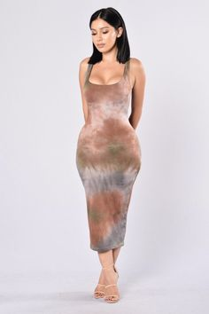 - Available in Olive Multi - Scoop Neckline - Midi Length - Tie Dye - Made in USA - 95% Rayon, 5% Spandex
