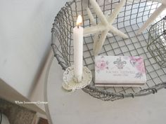 love this little book of matches set out by the candle in the wire basket with starfish