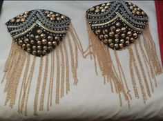Spiked out shoulder pads by richgirlsecrets on Etsy, $25.99