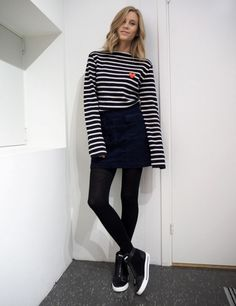 The Fashion Eaters wears a striped t-shirt, miniskirt, tights, and high-top sneakers