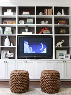 Living rooms - rope stools white built-ins tv back shelves lined brown paper fantastic white built-ins with backs of shelves lined wit… Built In Entertainment Center, Entertainment Room, White Built Ins, Ikea, Tv Shelf, Shelf Wall, Built In Bookcase, Bookcase Wall, Paint Bookshelf