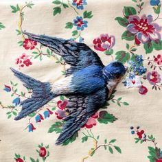 embroidered bird on floral fabric Embroidered Bird, Bird Embroidery, Beaded Embroidery, Cross Stitch Embroidery, Embroidery Patterns, Art Du Fil, Thread Painting, Floral Fabric, Textile Art