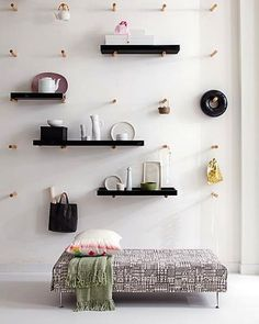 We love this peg wall design! Are you a fan? #interior