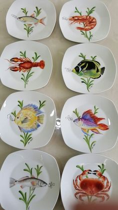Sea food plates painted by Aline Koyess Painted Plates, Hand Painted Ceramics, Ceramic Plates, Ceramic Pottery, Decorative Plates, Pottery Painting, Ceramic Painting, Ceramic Art, Fish Plate