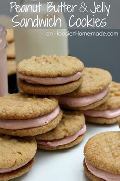 Peanut Butter & Jelly Sandwich Cookies: Recipe on HoosierHomemade.com. I'm not sure about the cool whip added to the filling...it makes a soft pink colour.