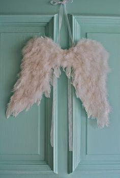 ~ pink angel wings on the front door <3