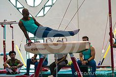 Gymnastics male gymnast on the horse apparatus doing his program before the judges at the regional competition held at Pinetown Gym Durban South-Africa Durban South Africa, Male Gymnast, Judges, Regional, Gymnastics, Competition, Royalty Free Stock Photos, African, Horses