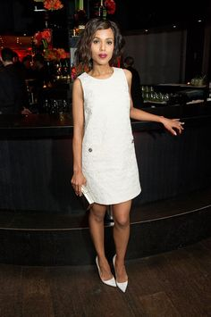 kerry washington all white ensemble with wavy short hair and a deep berry red lip