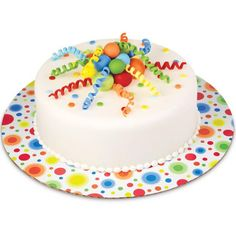 A bright bunch of fondant balls and curlicues burst from the top of this fun birthday cake!These easy-to-make decorations coordinate perfectly with Wilton's Colorful Circles Cake Boards.