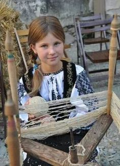 Făgăraş ­ -Young girl in traditional Romanian costume .