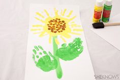 Handprint sunflower craft This keepsake is perfect for grandparents' day ;-) @SheKnows #sunflower #crafts #kids