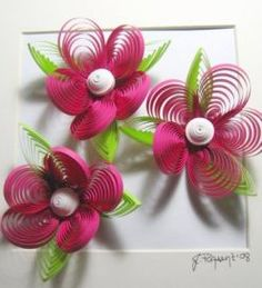 paper quilled flowers, perfect for gift wrapping.  Tutorial found here.