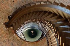 """This green """"Eye"""" is formed by a tall spiral staircase in a brick tower, reaching toward the bell inside the Lamberti Tower, Verona Italy. (You are looking upward into the bell tower:) By Davide Lombardi Beautiful Architecture, Art And Architecture, Architecture Details, Architecture Classique, Renaissance Architecture, Architecture Renovation, Take The Stairs, Stair Steps, Stairway To Heaven"""