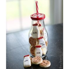 Milk & cookies decorated with Royal icing for year-end teacher appreciation gifts. Jars from the /target/ dollar bins. Mini milk bottle cutter from @trulymadplastics. Teacher thank you gift.