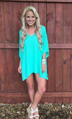 Gorgeous oversized tunic in Tiffany Blue. Perfect over a pair of our B123 White Jeggings, B123 Seamless Capri Leggings, or even to the pool as a swim cover-up. 100% Poly.