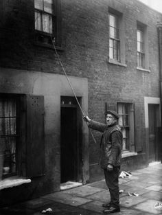 A Window Knocker Wakes a Client in London, 1929  via reddit  Though designs for alarm clocks date back to the ancient Greeks, they were still not particularly widespread well after the Industrial Revolution. In Britain and Ireland, a large number of enterprising early birds made a living waking people for work. A knocker-up would be paid a few pence a week to make the rounds and rouse workers, banging on their doors with a short stick or rapping on upper windows with a long pole. The…