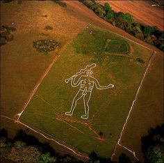 Hey, remember that news story from a while ago where that kid drew a giant penis on his parents' roof so it'd be captured on Google Earth? Well, it turns out that tradition goes back a long way.  The Cerne Abbas giant for instance has been around for centuries (nobody is sure who made it). It's formed out of a trench that uncovers the chalk under the soil, creating a permanent drawing of a dude with a huge dong. Wikipedia thoughtfully includes a close-up of his nuts.