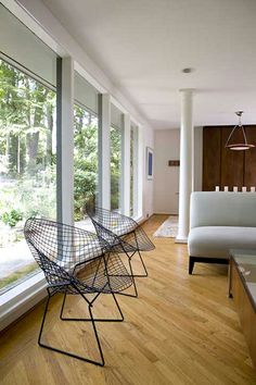 black-bertoia-armchairs-mid-century-modern