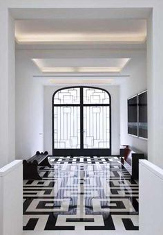 Graphic entry floors. I love the way the squares are repeated in the ceiling, the bench and artwork, even the door.